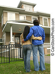 Young Couple Looking At House