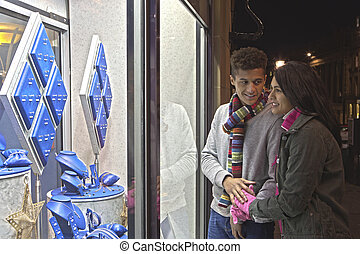 Young couple looking at jewellery