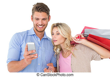 Young couple looking at mobile