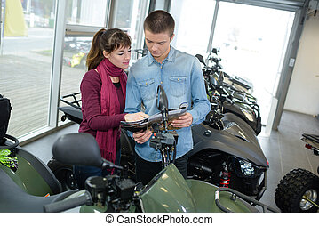Young couple looking at quads