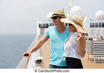 young couple looking at sea view - cheerful young couple...