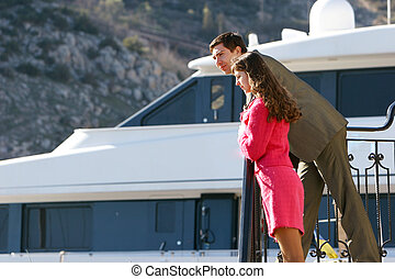 young couple looking at ship