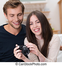 Young couple looking at their photographs