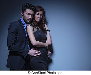 young couple looking into the camera - portrait of a young ...