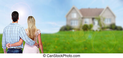 Young couple looking new home. - Young loving couple looking...