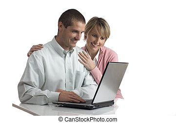 young couple looking on the laptop screen