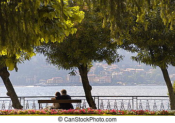 Young couple looking out over Lake Como from Ballagio, Italy