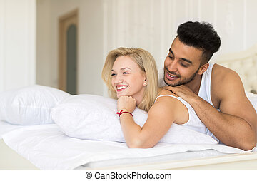 Young Couple Lying In Bed, Happy Smile Hispanic Man And Woman