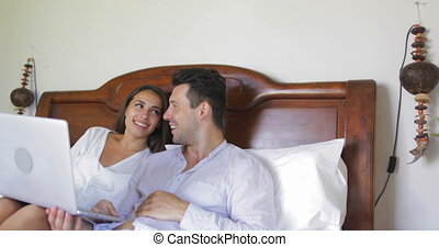 Young Couple Lying In Bed Use Laptop Computer Chatting Online, Beautiful Girl And Man In Bedroom Morning