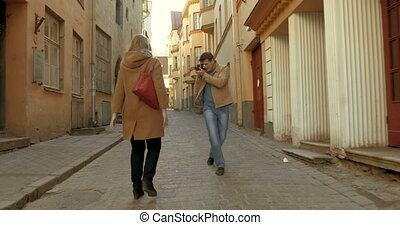 Young couple making film with retro camera