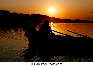 Young couple making romance in the boat