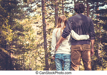 Young Couple Man and Woman Hugging in Love Romantic Outdoor with forest nature on background Fashion trendy style