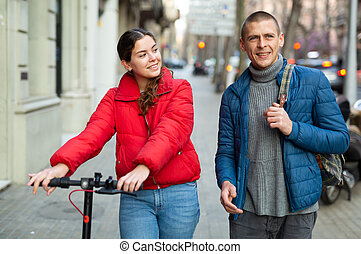 young couple man and woman walking outdoors