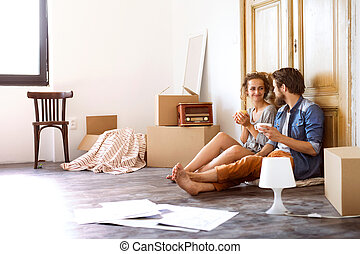 Young couple moving in a new house.