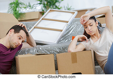 young couple moving in new apartment
