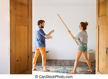 Young couple moving in new house fighting.