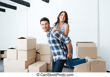 Young couple moving in new house