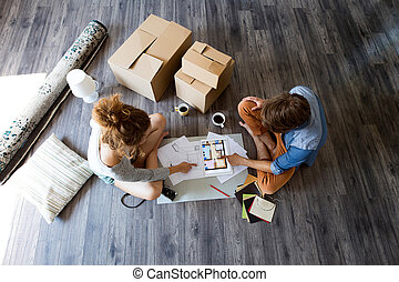 Young couple moving in new house.