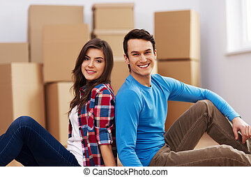 Young couple moving in their house