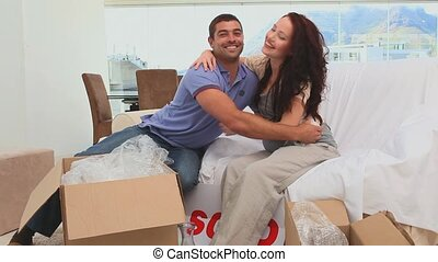 Young couple moving in their new ho