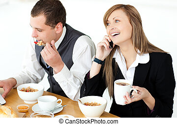 Young couple of business people having breakfast