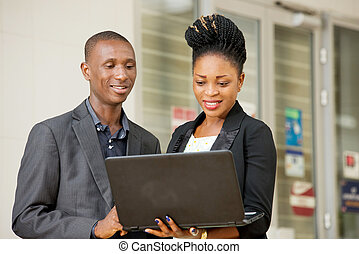 young couple of business people with a laptop.