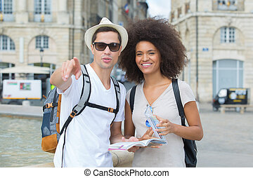 young couple of tourists in the city