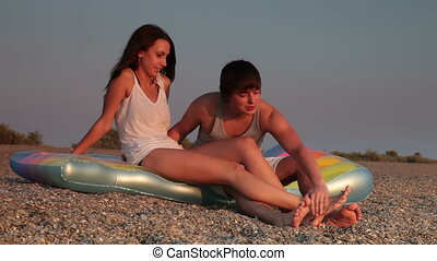 Young couple on a beach talking
