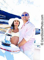 Young couple on a luxury boat