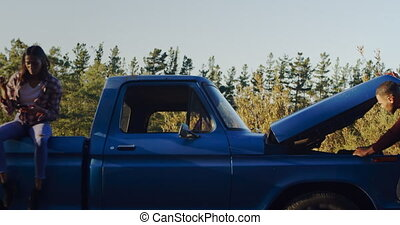 Young couple on a road trip in their pick-up truck - Front ...