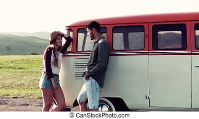 Young couple on a roadtrip through countryside, talking. - A...