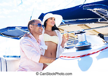 Young couple on a sailing boat