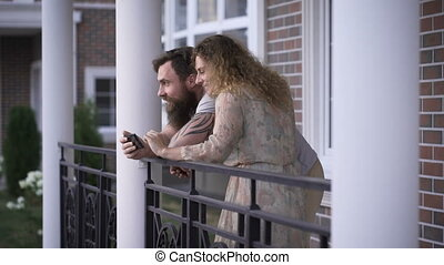 Young couple on a terrace of the house.