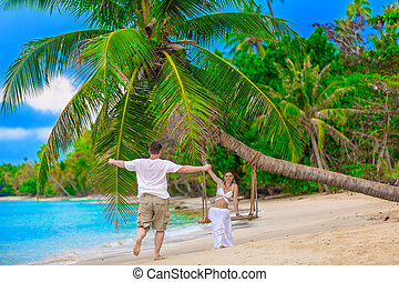 young couple on a tropical beach