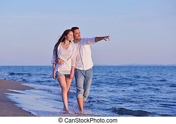 young couple on beach have fun - happy young romantic couple...