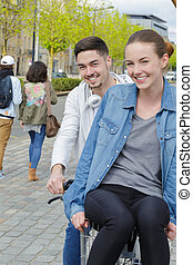 young couple on bicycle in the city