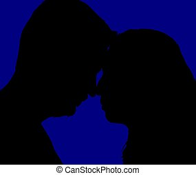 Young couple on blue  background.
