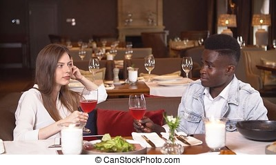 Young couple on date in restaurant