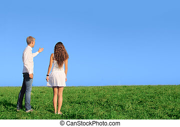 Young couple on field