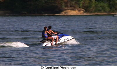 Young Couple on Jet Ski - Young couple on jet ski take off...