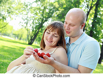 Young couple on picnic in the park