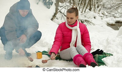 Young Couple On Picnic In Winter