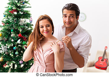 Young couple on romantic christmas date