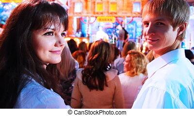 young couple on shooting Christmas TV show, closeup
