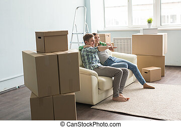 Young couple on sofa moving into new house