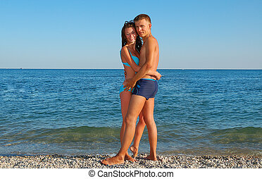 young couple on summer beach