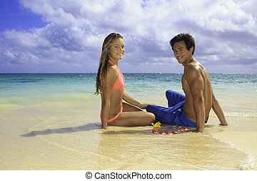 young couple on the beach in hawaii