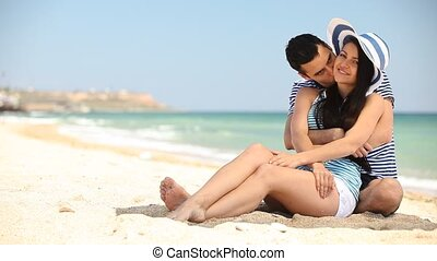 Young couple on the beach in summer
