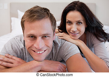 Young couple on the bed together
