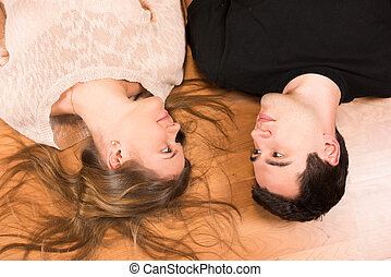 Young couple on the floor